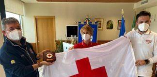 Croce Rossa, consegnata bandiera Cri al presidente Spirlì